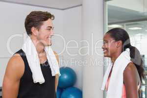 Personal trainer and client smiling at each other