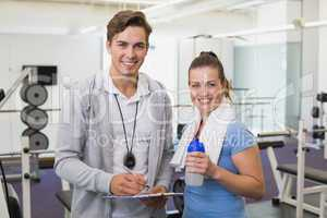 Personal trainer and client smiling at camera