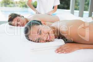 Couple enjoying massage at health farm