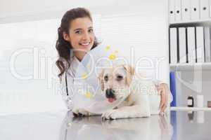 Smiling vet and dog with a cone