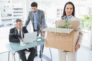 Unhappy businesswoman being let go