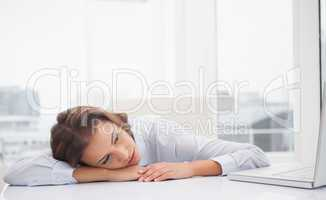 Tired businesswoman resting at her desk