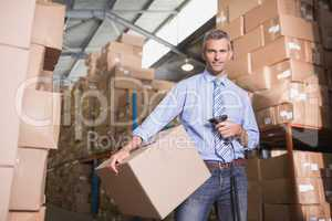 Manager scanning package in warehouse