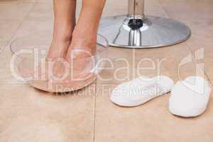 Customer soaking feet at salon