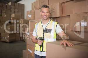 Worker scanning package in warehouse