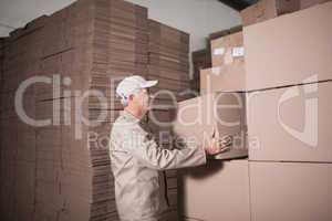 Warehouse worker loading up pallet