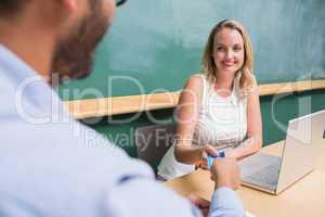 Beautiful businesswoman interviewing man