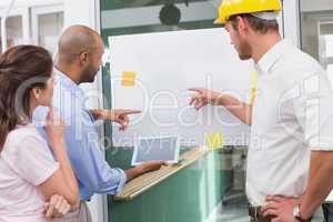 Architect team brainstorming together using digital tablet