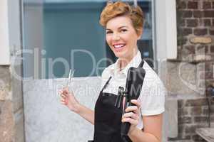 Confident hairdresser smiling at camera
