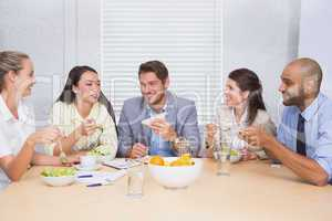 Workers laughing while enjoying lunch break