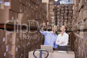 Colleague with laptop at warehouse