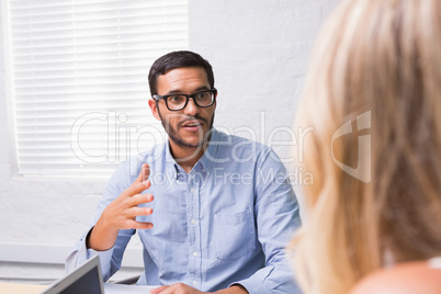 Young businessman interviewing woman