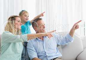 Nice parents and daughter pointing something