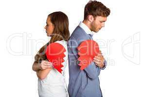 Young couple holding broken heart