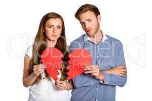 Couple holding broken heart