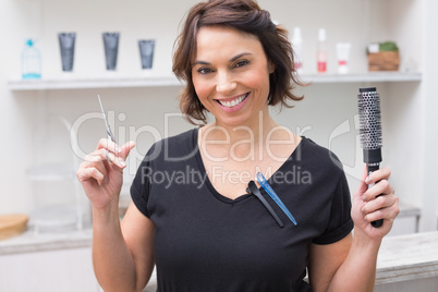 Hair stylist smiling at camera