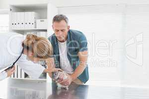 Vet giving a rabbit a check up