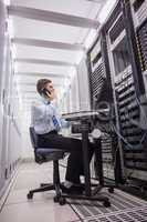 Technician talking on phone while looking servers
