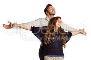 Romantic young couple with arms out