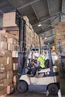 Forklift machine in warehouse