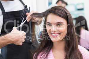 Pretty brunette getting her hair cut