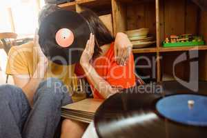 Young couple listening to vinyl record