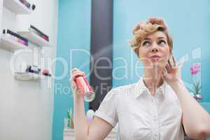 Customer using hair spray