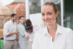 Casual blonde businesswoman smiling at camera