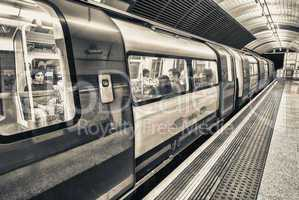LONDON - SEPTEMBER 28, 2013: Subway train in underground station