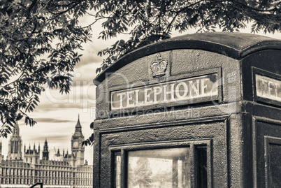 Traditional telephone booth along river Thames, Westminster Pala