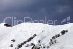 Off piste slope and overcast sky in windy day