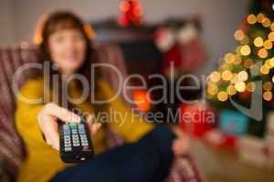 Red hair using remote control at christmas
