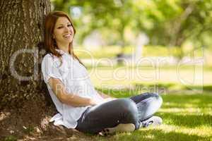 Pretty redhead sitting in casual clothing