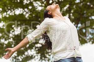 Brunette smiling and enjoying her freedom