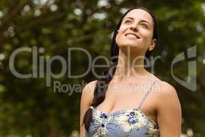 Portrait of a brunette enjoying the sunshine