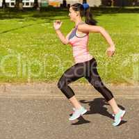 Fit brunette going faster on path