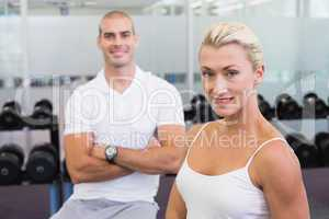 Portrait of a sporty couple at fitness studio