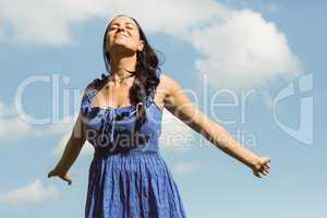Pretty brunette in dress enjoying the sunshine