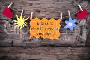 Orange Label With Life Quote Life Is To Short To Waste A Moment