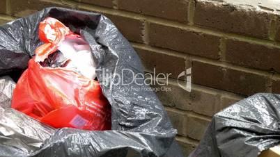 A black trash bag with garbage GH4 4K