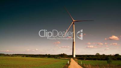 A big windmill on standby on a green field FS700 4K RAW Odyssey 7Q
