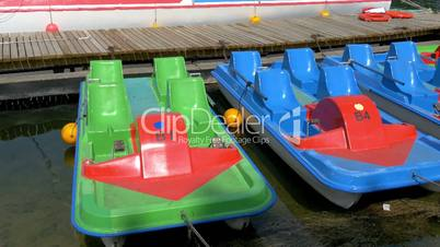 Some colorful water bicycle for tourists of the old castle GH4 4K UHD