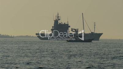 A warship on standy and a small viking boat crossing GH4 4K UHD