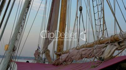 Ropes and rolled big clothes on the sail mast of the ship GH4 4K