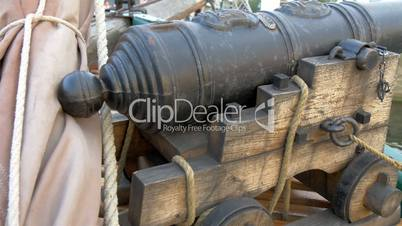 A small cannon handicraft on the boat on dock  GH4 4K