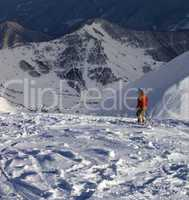 Skier on off-piste slope in sunny evening