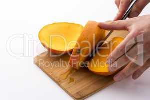Trisecting A Mango Along Its Flat, Oblong Pip