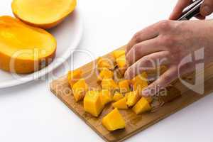 Juicy Mango Fruit Pulp Diced On A Kitchen Board