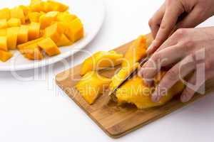 Cutting Juicy Fruit Pulp Around A Mango Pit