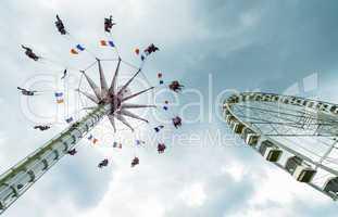 Amusement park against cloudy sky